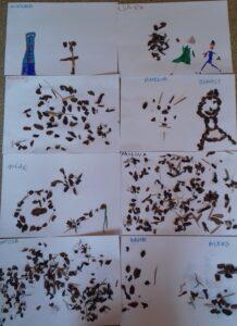 Kartki papieru z naklejoną korą i namalowanymi flamastrami postaciami