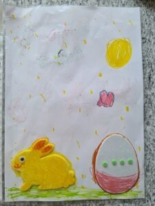 Kartka świąteczna z naklejonym zajączkiem i jajkiem