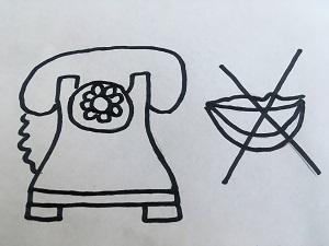 Na białej kartce A4 znajduję się narysowany telefon i przekreślone usta