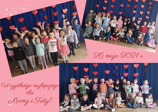 Dzieci z Przedszkola nr 148 pozują do zdjęcia na tle czerwonych serc na granatowym tle